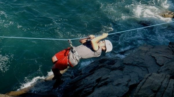 Rope climbing over rapids