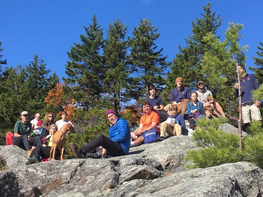 Campers on rocky hill