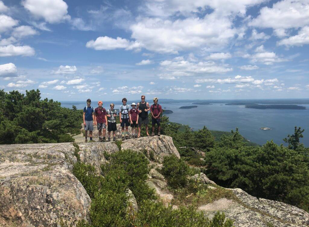 Campers hiking in Maine